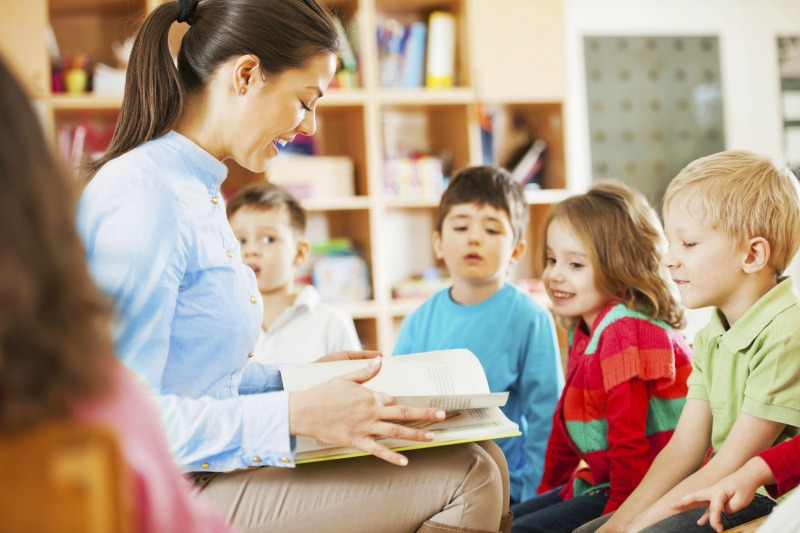 kindergarten teacher reading to children SMALL